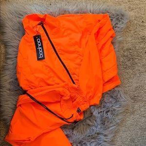 Neon orange cropped jacket, and pants
